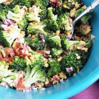 Prepared broccoli salad in a blue bowl