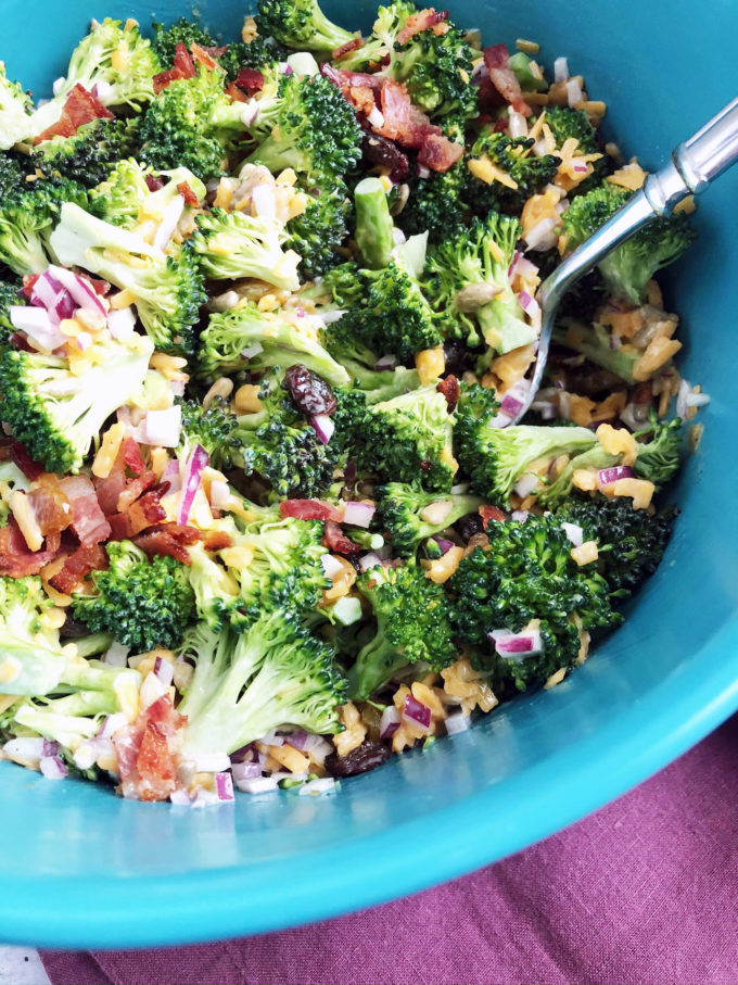 The best recipe for easy broccoli salad made with golden raisins, red onion, fresh broccoli florets, light mayonnaise, and sharp cheddar cheese.  The perfect summer side dish! #broccolisalad #saladrecipes #summersidedish via @Ameecooks