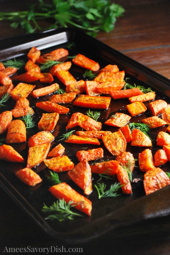 Roasted carrots with herbs on a cookie sheet