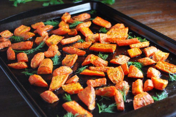 This is the best recipe for herb roasted carrots made with olive oil and fresh dill and makes the perfect holiday side dish.