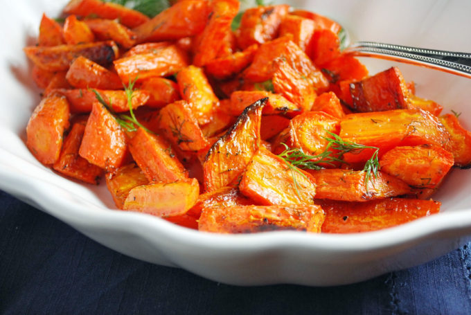 Roasted carrots in a white serving