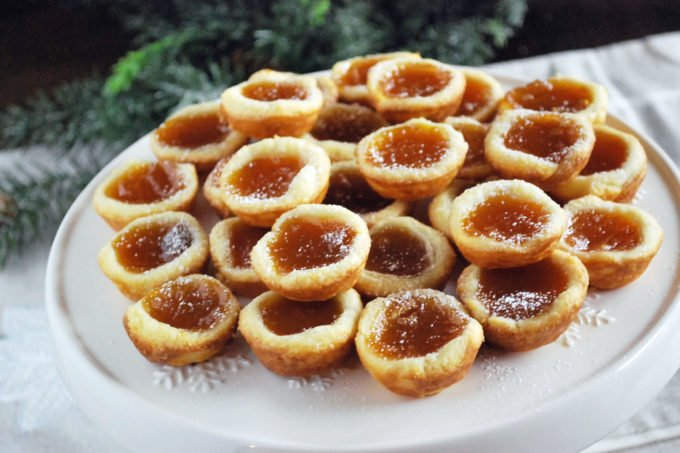 A family favorite holiday cookie recipe for homemade apricot tarts made with apricot filling and homemade cream cheese dough.