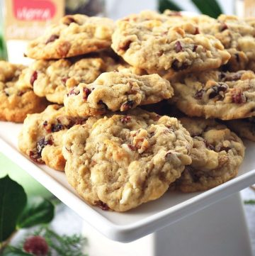 close up photo of platter of white chocolate cranberry oatmeal cookies