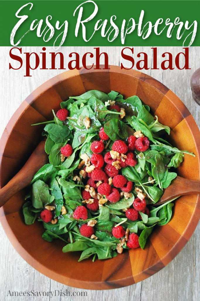 overhead shot of raspberry spinach salad in a wooden bowl