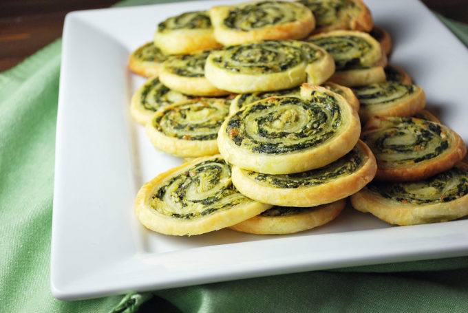 Spinach and Artichoke Pinwheel Appetizers are a delicious combination of puff pastry dough, spinach, marinated artichokes and Parmesan cheese.