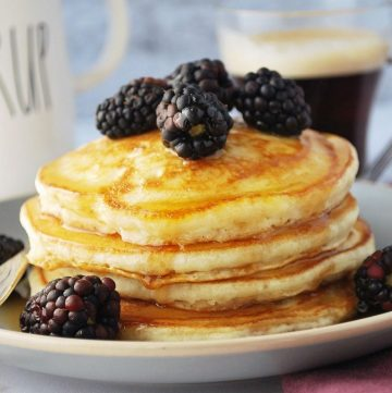 plate of clean eating pancakes with syrup and berries