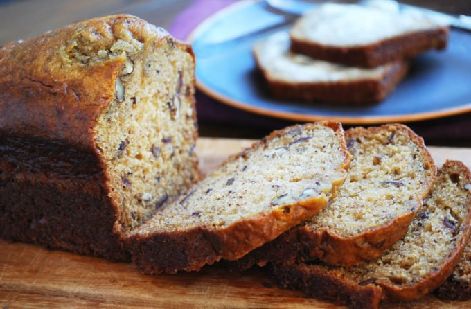 This family favorite date nut bread recipe is moist, flavorful and incredibly delicious! Made with Greek yogurt and olive oil, it's a healthier alternative to regular quick bread.
