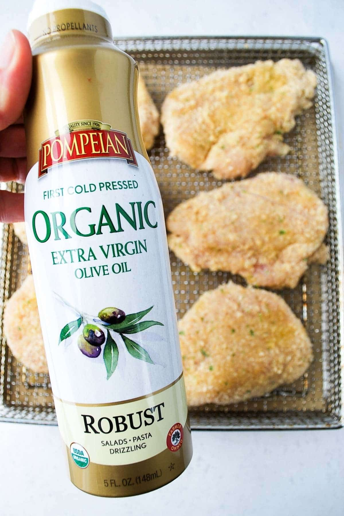 ready to spray cooking oil on breaded chicken breasts