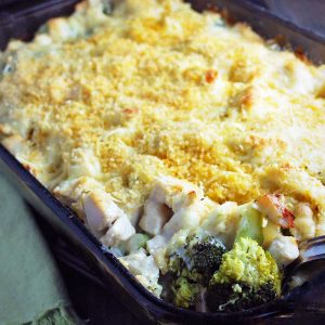 chicken Divan in a baking dish fresh from the oven with a serving spoon dipped inside