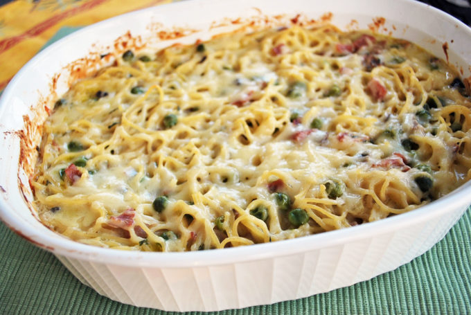 Creamy Ham and Spaghetti Casserole recipe is a one dish meal made with chopped ham, peas, mushrooms, onions and pasta and a simple, delicious and kid-friendly recipe.