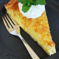 a slice of crustless coconut pie and a fork on a plate