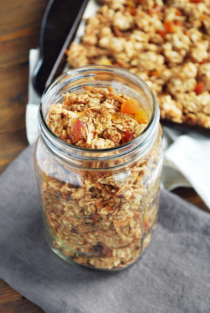 The best easy homemade granola recipe stored in a mason jar