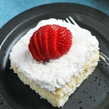 slice of coconut cake with a strawberry on top