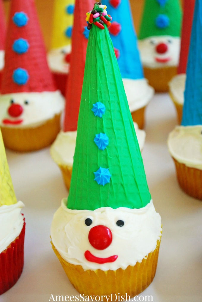 A simple recipe for making clown cupcakes using ice cream cones, M&M's, colored frosting and sprinkles from Amee's Savory Dish