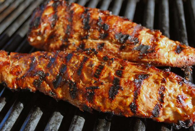 bourbon pork tenderloin cooking on the grill