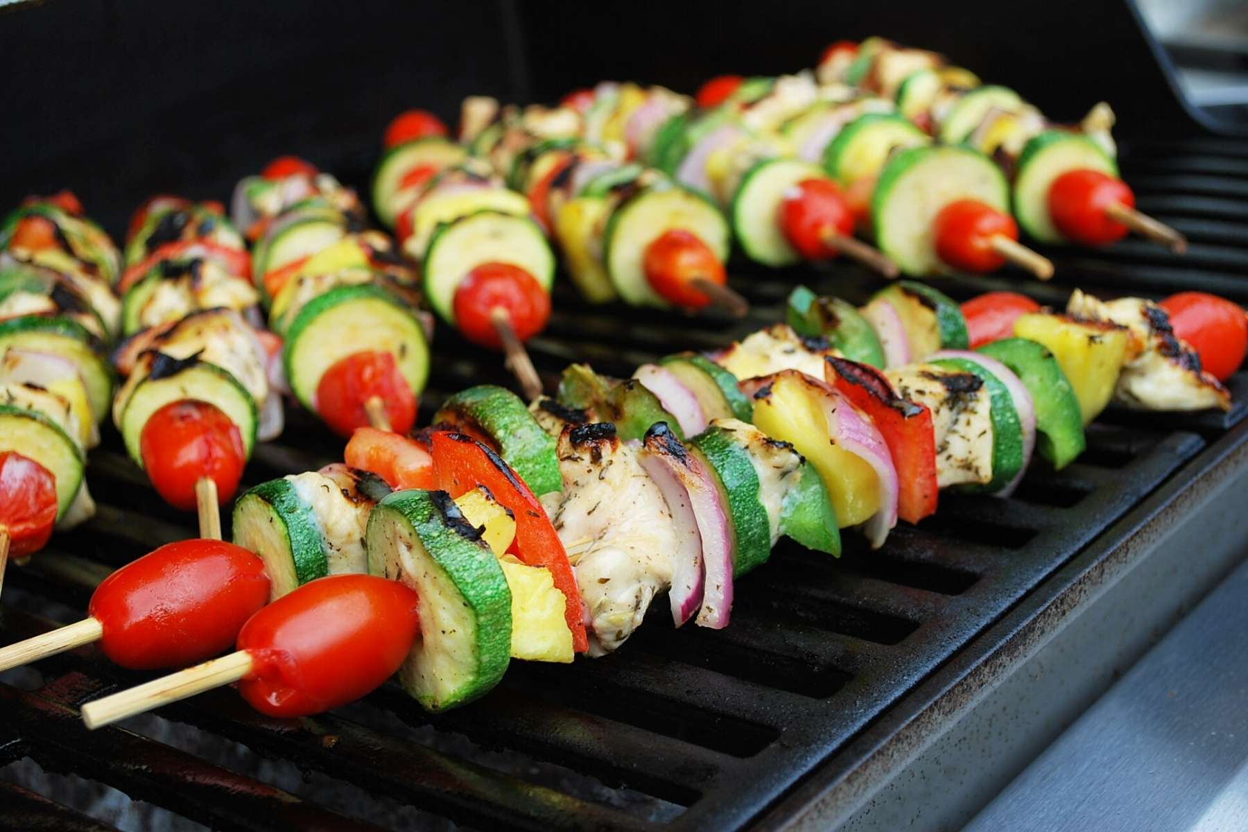 kabobs cooking on a grill