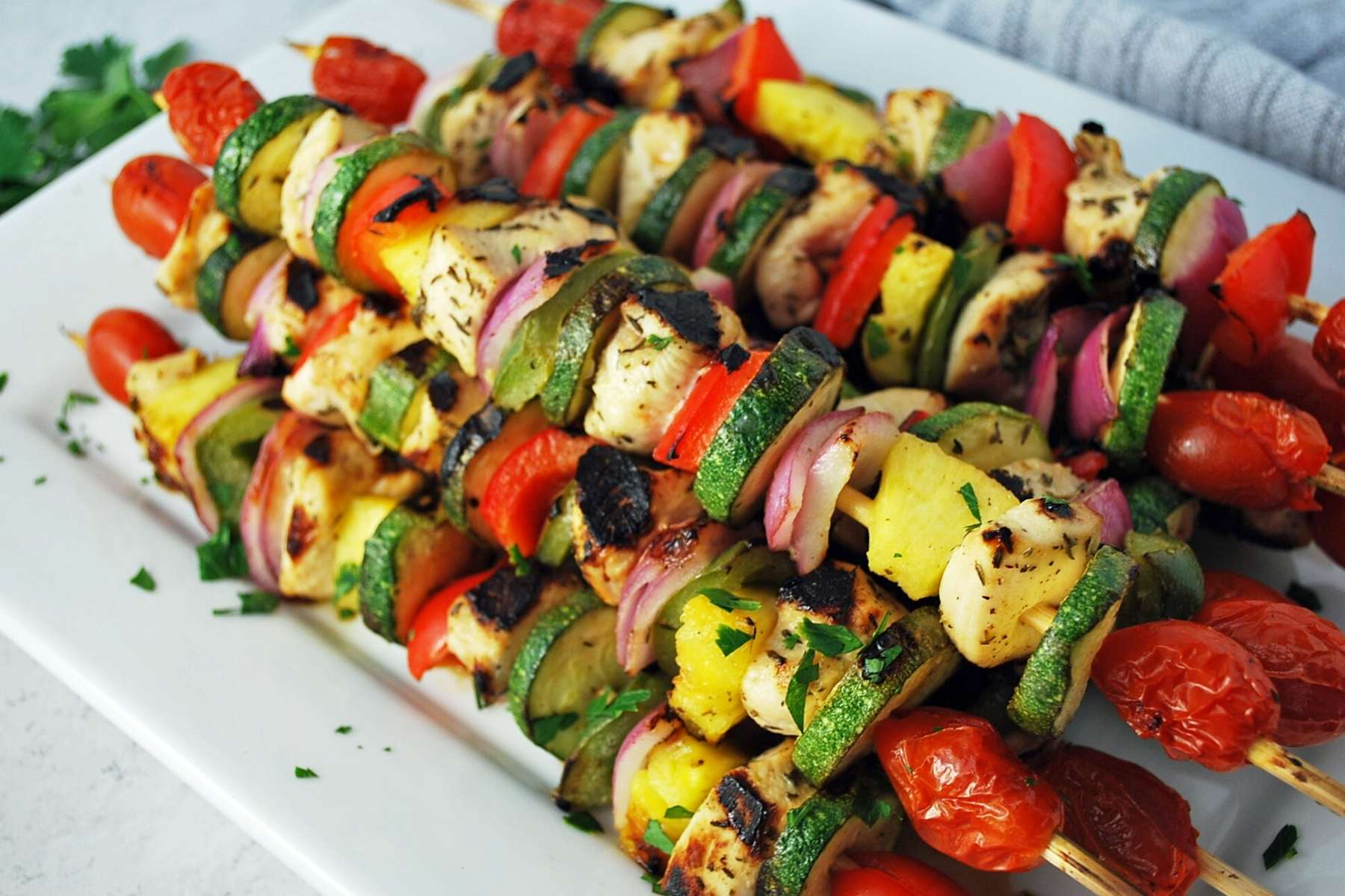 side view of a platter of chicken kabobs