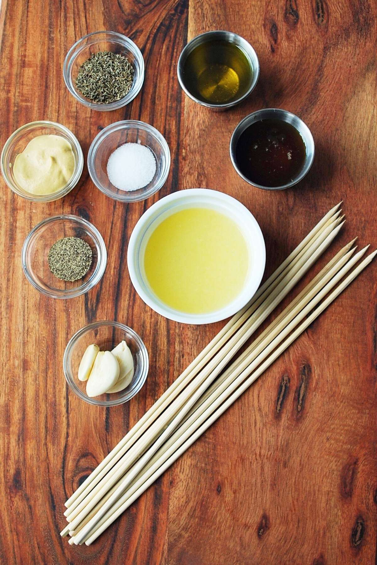 marinade ingredients for kabobs on a wooden board