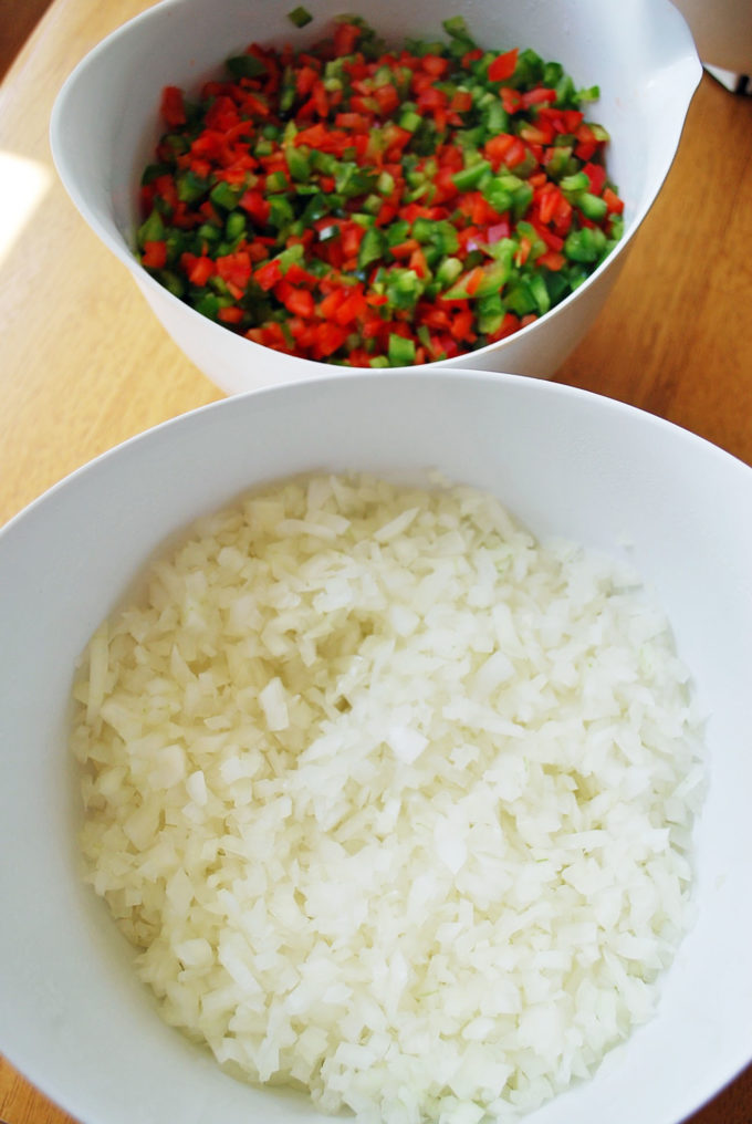 This homemade cucumber relish made with peppers, onions, vinegar and spices doesn't require canning, so it's easy to make and makes the perfect topper or side dish.