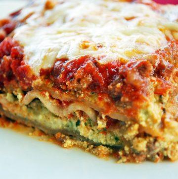 close up of a single slice of lasagna