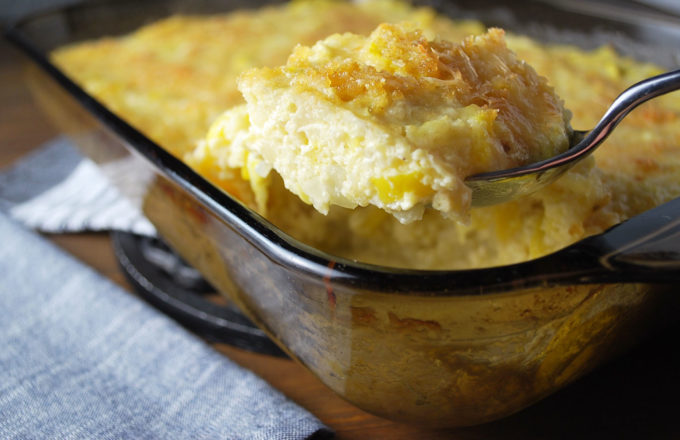 Squash Cauliflower Rice Casserole is a low-carb and gluten-free recipe made with fresh yellow squash, onions, riced cauliflower, cheese and ground pork rinds.   This satisfying comfort food dish can easily fit into a healthy eating plan.