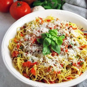 bowl of pasta tossed with fresh tomato basil pasta sauce