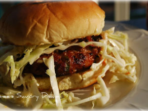 Asian style pork burgers topped with Asian slaw