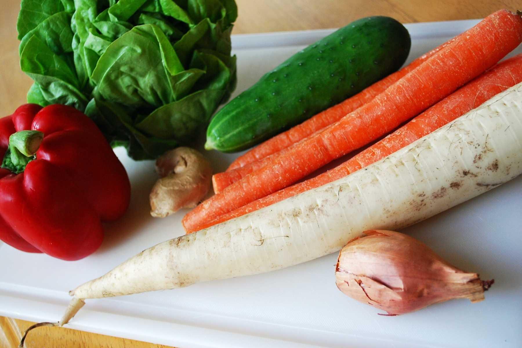 fresh vegetables for salad rolls on a cutting board