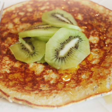 Banana protein pancake with fresh kiwi fruit