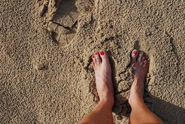 feet in the sand on a Punta Cana beach