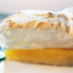 a slice of orange meringue pie