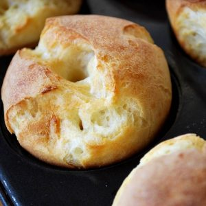 popovers freshly baked in a muffin pan