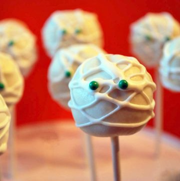 Mummy cake pops with green candy eyes