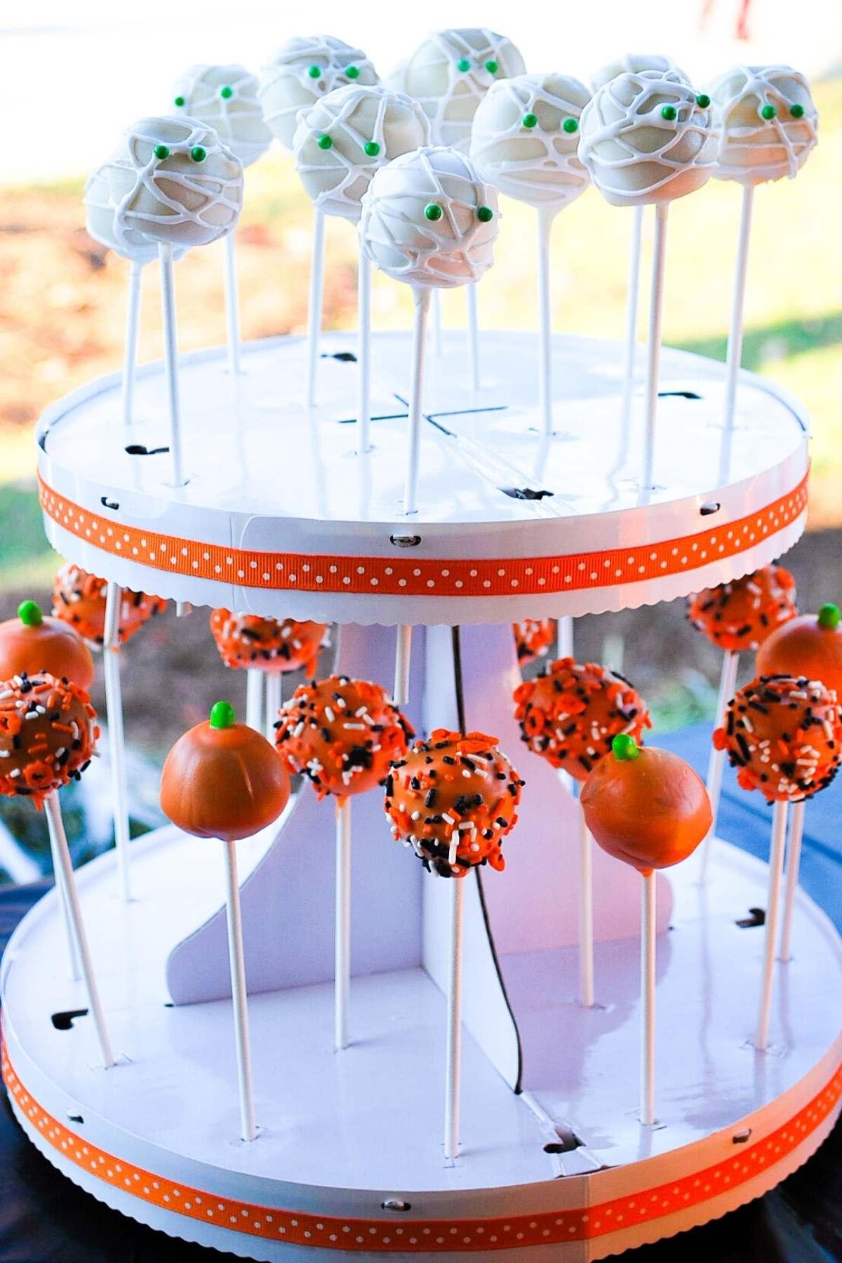 Halloween cake pops displayed in a 2 tier cake pop holder