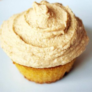 a vanilla cupcake with a swirl of peanut butter frosting