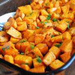 rosemary sweet potatoes on a baking sheet