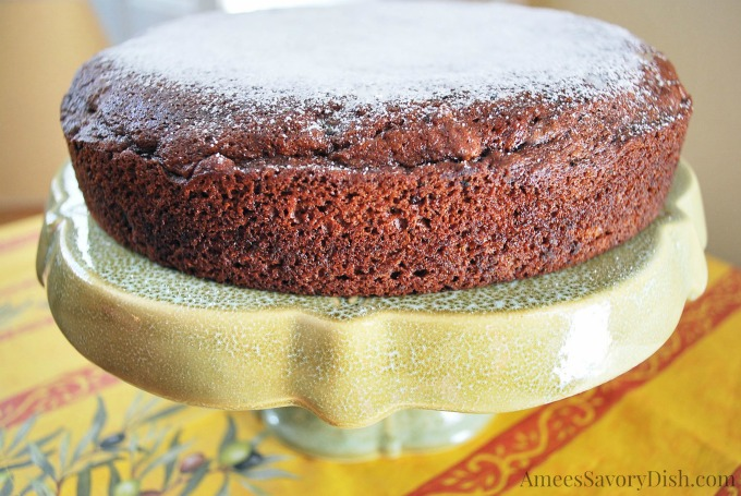 date nut cake on a yellow cake stand