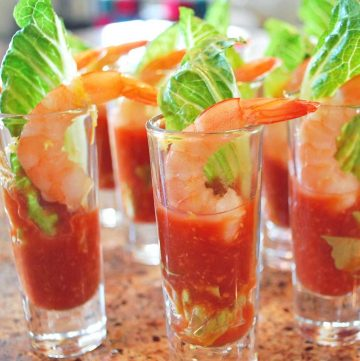 mini glasses with a shrimp and garnishes