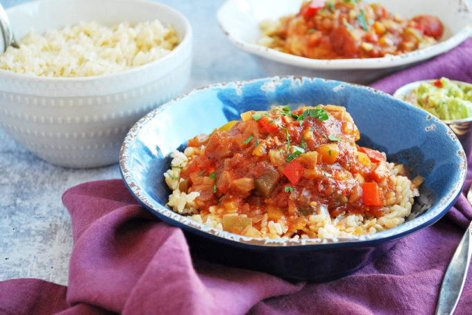 Easy Sweet and Spicy Crockpot chicken served with rice