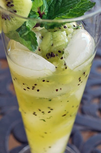 side view of a kiwi mojito in a glass