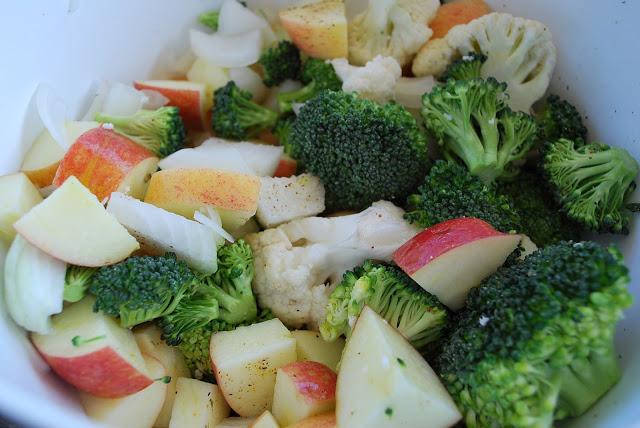 Cut up broccoli, onions, cauliflower, and apples
