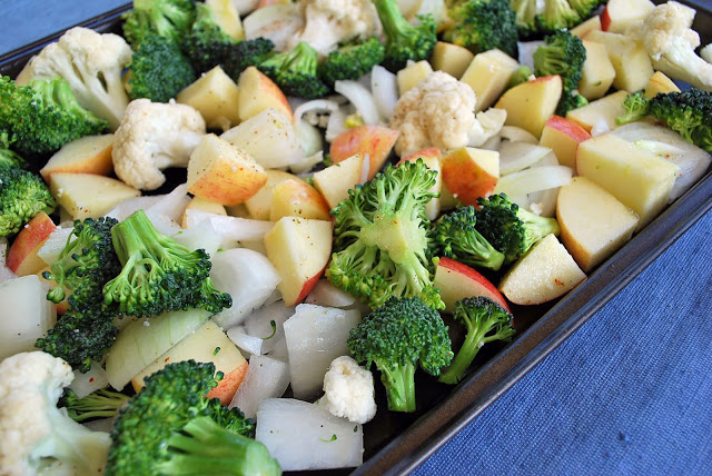 Fresh vegetables and apples, sliced and ready to roast