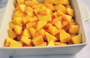 Baking dish with chopped fresh peaches