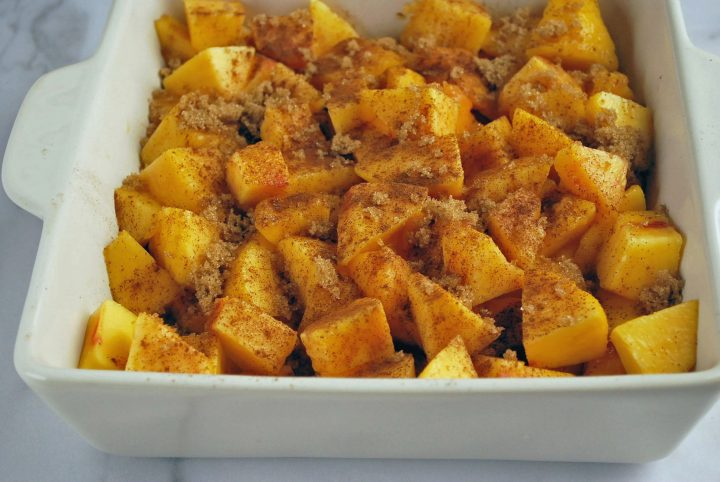 peaches topped with cinnamon and sugar