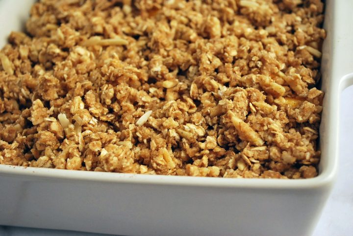peach crisp assembled and ready to bake