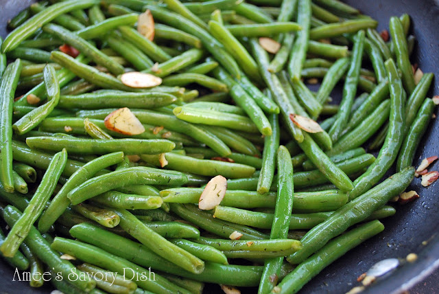 These sautéed green beans are my absolute favorite.  They are quick and full of flavor, made with chicken stock, butter, garlic, fresh dill and topped with toasted slivered almonds.