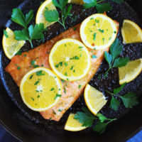 organge ginger salmon and orange slices on a platter
