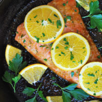 A flavorful recipe for baked salmon made with extra virgin olive oil, soy sauce, honey, orange zest, and fresh ginger root.  It's fast, easy and delicious!