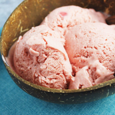 A close up of a bowl of frozen fruit ice cream