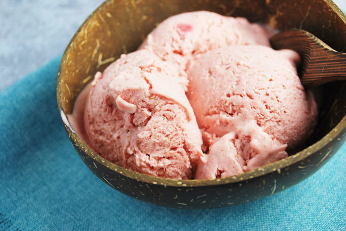 A delicious and easy blender recipe for strawberry frozen fruit ice cream made with frozen banana, strawberries and coconut milk that's protein-packed with muscle-building whey.